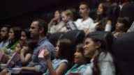 Group of people in the cinema watching a movie