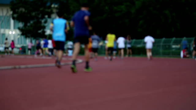 Group of people jogging on the running track