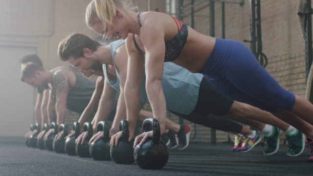 Group of people making push-ups
