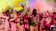 Group of people playing holi and dancing, Delhi, India