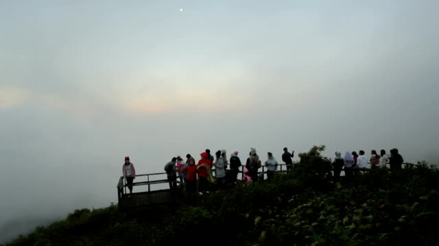 Group of people relax and enjoy beautiful panorama of mountain