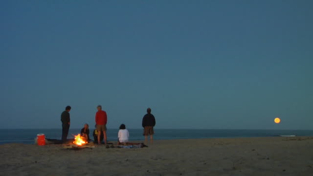 WS, Group of people sitting at bonfire on beach, North Truro, Massachusetts, USA