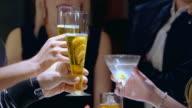 CU group of people toasting drinks