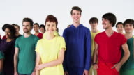 Group of People Wearing Monochromatic Colors and Smiling