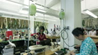 WS T/L TD Group of people working in fashion designer's workshop / New York City, New York, USA
