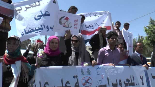 A group of protesters gather outside the Sanaa University on March 29 2015 to stage a demonstration against antiHouthi offensive by Saudiled Arab...