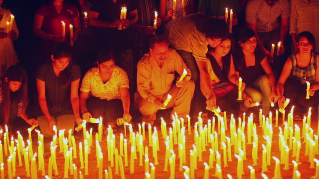 Group of Protestors burning candles, Delhi, India