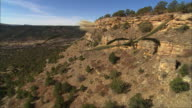 CGI, AIR TO AIR, Group of Pterosaurses  flying above rocky landscape