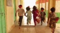 Group of rajasthani kids running in a school, Jaisalmer, Rajasthan, India