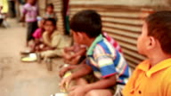 Group of rural children eating food asking for education