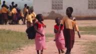MS Group of school children walking through school yard, Tamale, Ghana