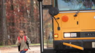MS TD SELECTIVE FOCUS Group of school students (4-7) disembarking from school bus / Richmond, Virginia, USA