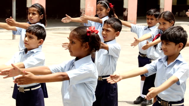 Group of school students doing exercising, Haryana, India