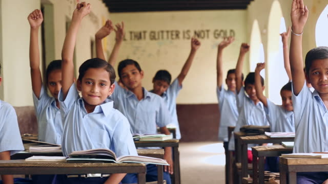 Group of school students hand raised, Haryana, India