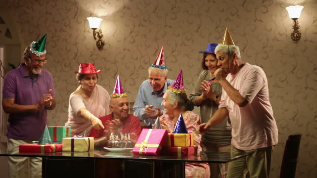 Group of senior people celebrating birthday party video id140807300?s=640x640
