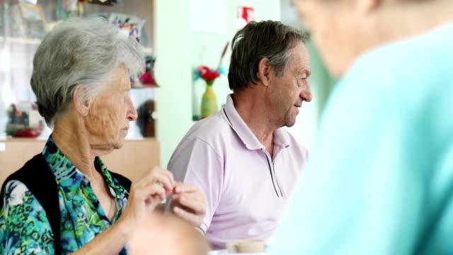 Group of Seniors Socializing in Retirement Home