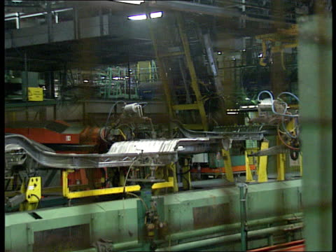 Group of seven talks ITN LIB Ellesmere Pt MS Car bodies on production line at Vauxhall motors plant