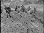 B/W 1920 group of sharecroppers hoeing field / Southern US / documentary