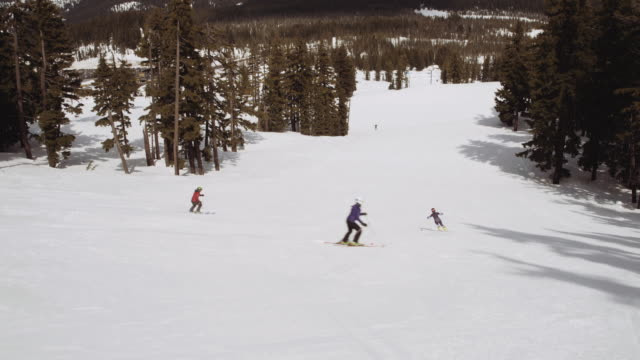 A group of skiers racing down the mountain