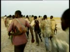 Group of soldiers marching, following oil exploitation, Nhialdiu, Western Upper Nile, Sudan