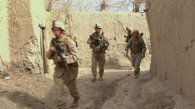 WS Group of soldiers walking in row / Musa Qala Helmand Province Afghanistan