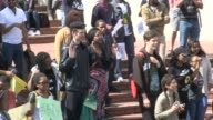 A group of students shout slogans and hold banners during an antixenophobia demonstration against the alleged racist attitude of the administration...