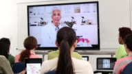 WS DS Group of Students Video Conferencing with Scientist Professor in Laboratory / Richmond, Virginia, United States