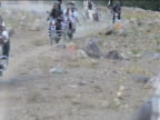 Group of Taliban forces ride through mountainous region on motorcycles Afghanistan 2 December 2009