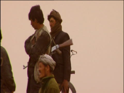 Group of Taliban soldiers gathered around Ghazni minaret Afghanistan 2002