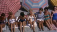 MS Group of teenage girls sunbathing on beach,Viareggio's sandy beach, Tuscany, Italy.