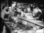 B/W 1943/44 group of teenagers drinking sodas at soda fountain counter / Springfield, NJ / newsreel
