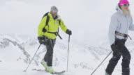 MA PAN Group of three mountain climbers trekking on snow and ice covered mountain in Austrian Alps at snow storm / Stubai Glacier, Tirol, Austria