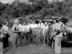 A group of tourists talk to Eric Sherbrooke Walker owner of the Treetops hotel at the start of a safari in the Aberdare National Park
