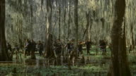 MS Group of union soldiers searching wooded swampland