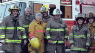 PAN, Group of Volunteer Fire Fighters in Front of Fire Truck, Eastville, Virginia, USA