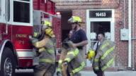 PAN, Group of Volunteer Fire Fighters Running to Fire Truck, Eastville, Virginia, USA