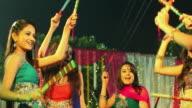 Group of women celebrating dandia festival, Delhi, India