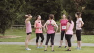 Group of women gathered before a run for breast cancer awareness