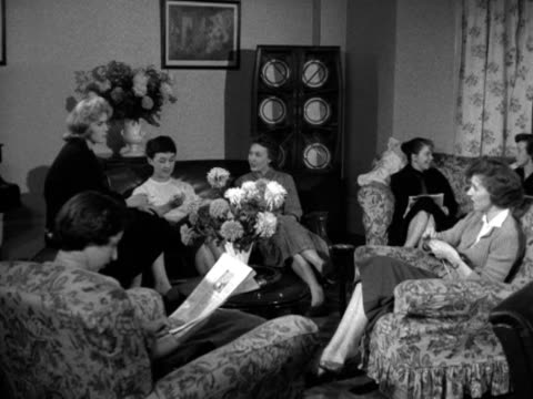 A group of women sit and relax in a lounge at a hostel for female employess of Barker's department store 1956