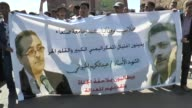 A group of Yemeni students stage a protest against the assassination of senior leader of Yemen's Shiite Houthi movement AbdelKarim alKheiwani who was...