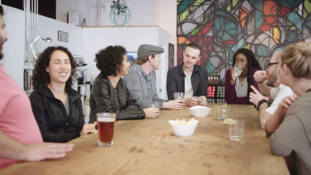 Group of young adults meeting for drinks