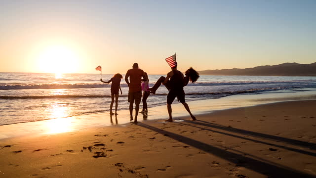 Group of young people celebrating on the beach