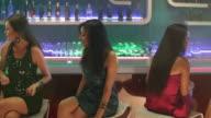Group of young women enjoying at bar counter