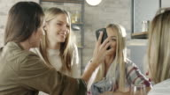 Group of young women looking at phone