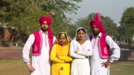 ZO, WS, Group portrait of two Sikh couples outdoors, Amritsar, Punjab, India