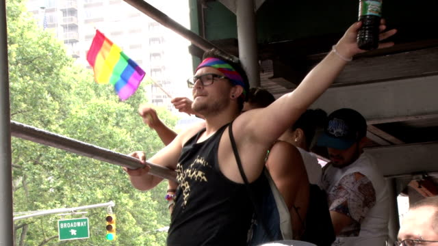 Groups of young people come together at the annual Gay Pride Parade in New York City to celebrate the recent Supreme Court decision making same sex...
