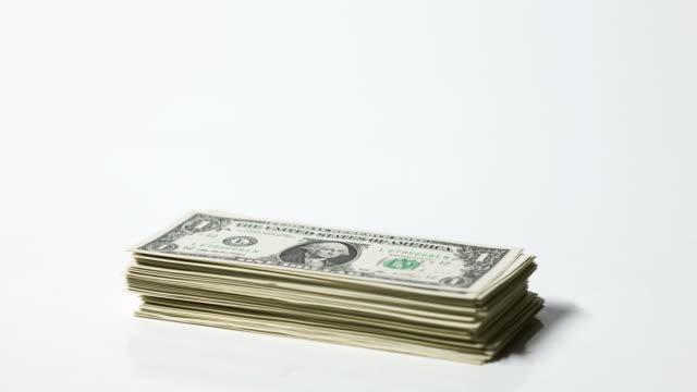 CU T/L Growing pile of one dollar bills