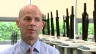 UK growth forecast downgraded by IMF ENGLAND Oxfordshire Wantage EMS Physio INT James Greenham showing reporter physio equipment on factory floor and...