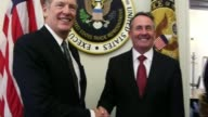 UK growth forecast downgraded by IMF Washington DC PHOTOGRAPHY*** Liam Fox MP along shaking hands with Robert Lighthizer Liam Fox MP speech SOT