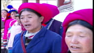 Growth of Christianity Tibetan Christians perform traditional songs and dance outside church Father Tao Zhubin watching singing and dancing Elderly...
